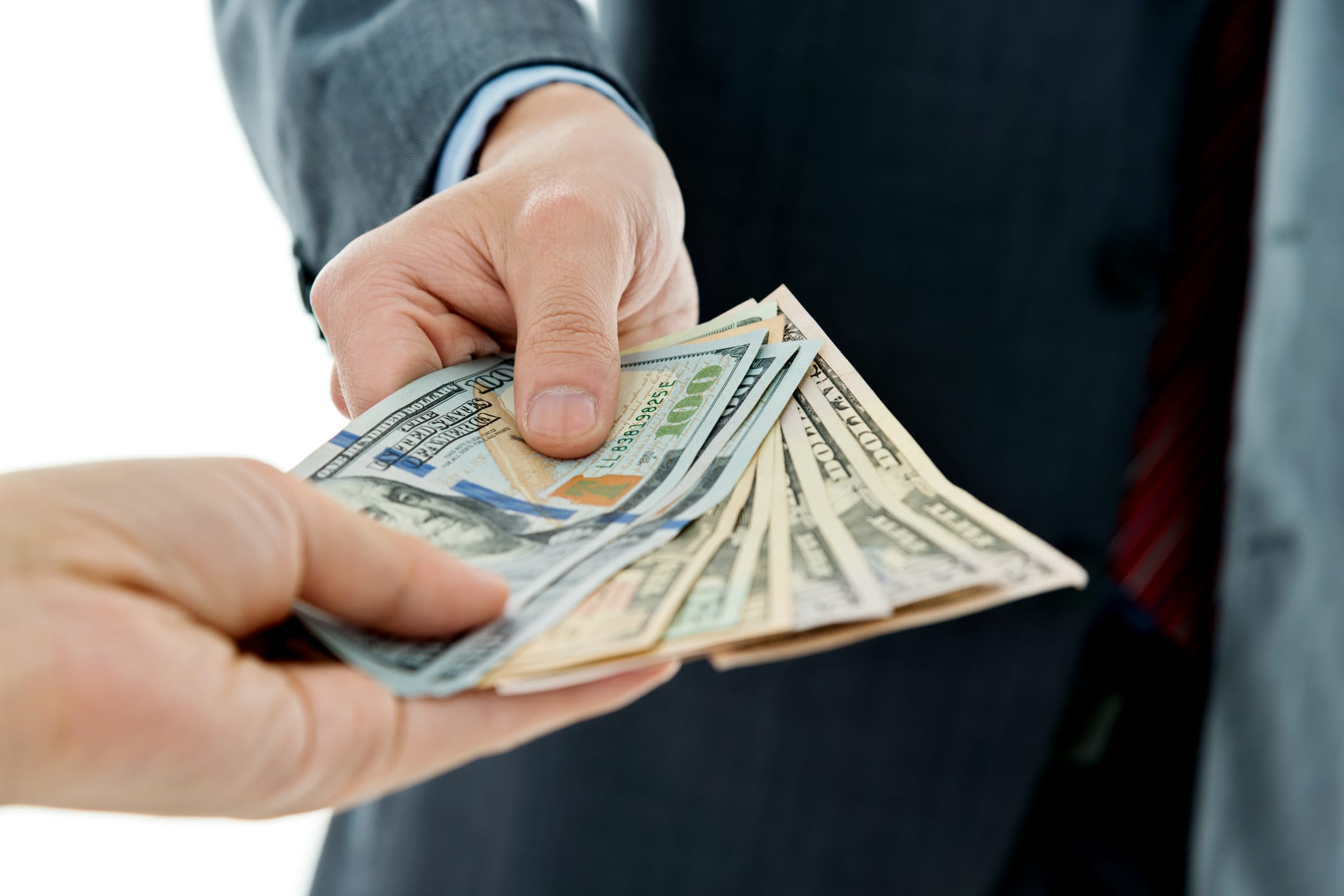 businessman hands giving money.